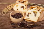 picture of home-made bread  - slice of home made raisin bread with died raisin - JPG