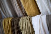 picture of chokers  - Close up of cotton scarves on a shelf  - JPG