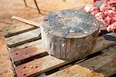 foto of slaughter  - Stump tree for cutting the meat - JPG