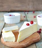 picture of brie cheese  - piece of brie cheese on wooden board - JPG