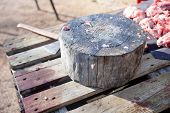 stock photo of slaughter  - Stump tree for cutting the meat - JPG