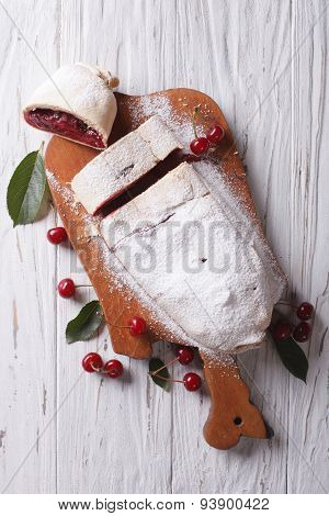 Cherry Strudel On A Wooden Board. Vertical Top View