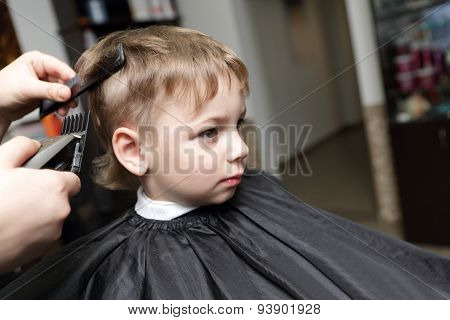 Serious Child Having A Haircut