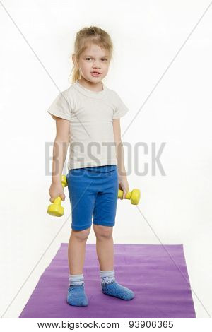 Funny Four-year Girl With Dumbbells