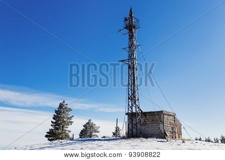 Meteorological Tower On The Top Of Ai-petri Mountain. Snow And Frosted Pine Trees In Sunny Day.