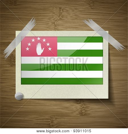 Flags Abkhazia At Frame On Wooden Texture. Vector