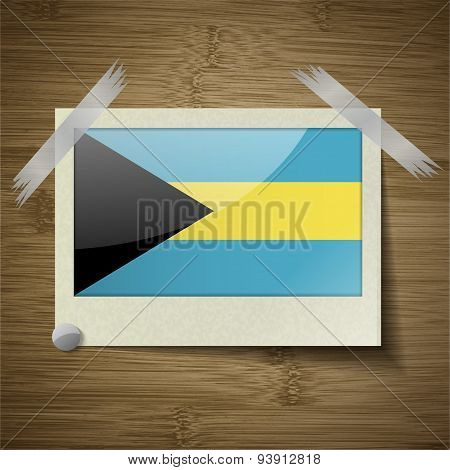 Flags Bahamas At Frame On Wooden Texture. Vector