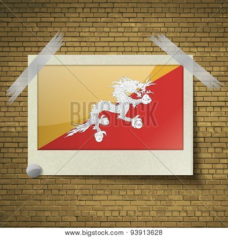 Flags Of Bhutan At Frame On A Brick Background. Vector