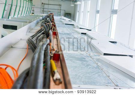 Electric and fiber optic cables.
