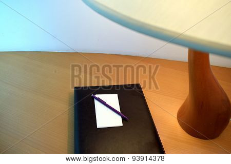 Table Lamp beside the book with Pencil