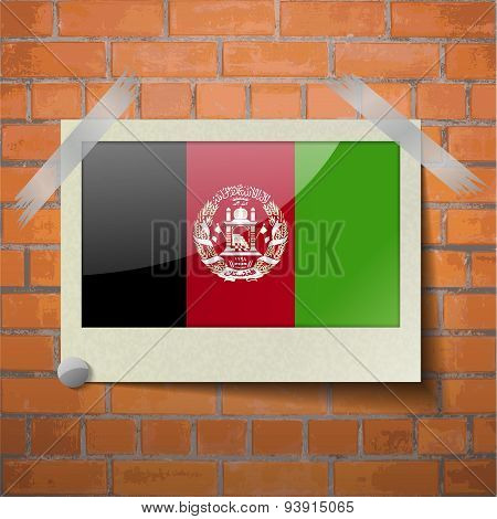 Flags Afghanistan Scotch Taped To A Red Brick Wall