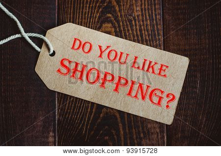 Do you like shopping? Blank tag on dark wood background