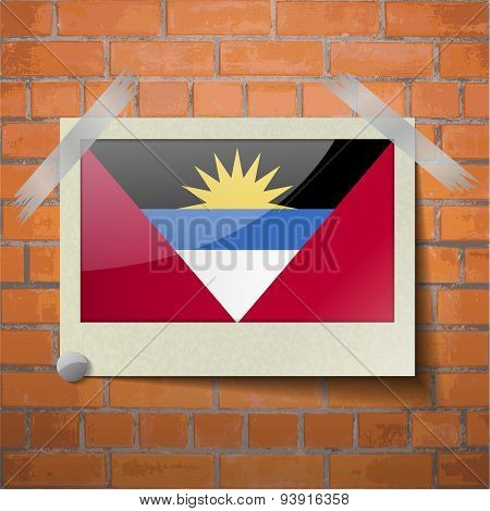 Flags Of Antigua And Barbuda Scotch Taped To A Red Brick Wall