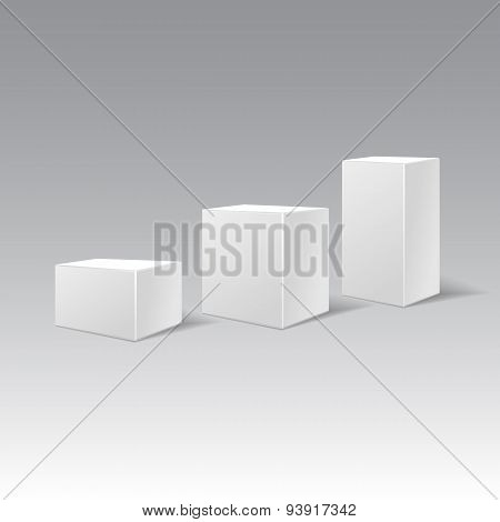 Three White Cardboard Gift Rectangular Boxes Different Height.