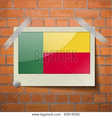 Flags Benin Scotch Taped To A Red Brick Wall