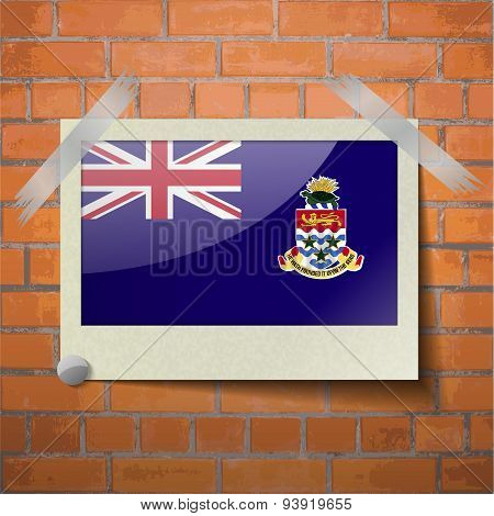 Flags Cayman Islands Scotch Taped To A Red Brick Wall