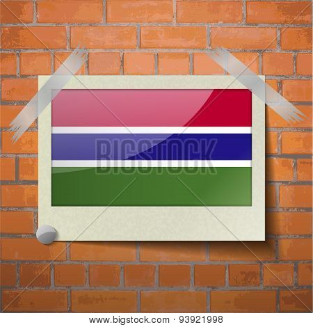 Flags Gambia Scotch Taped To A Red Brick Wall