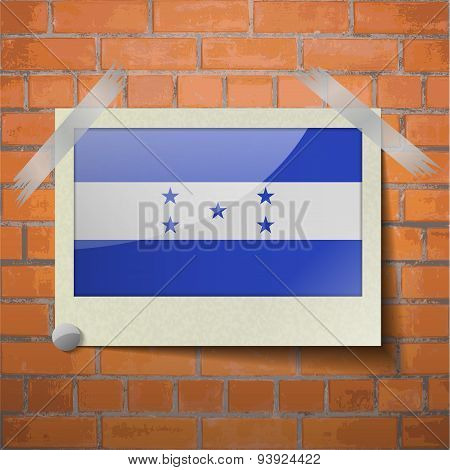 Flags Honduras Scotch Taped To A Red Brick Wall