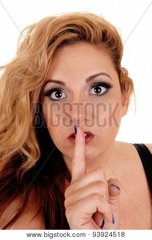 Woman Holding Finger On Mouth.