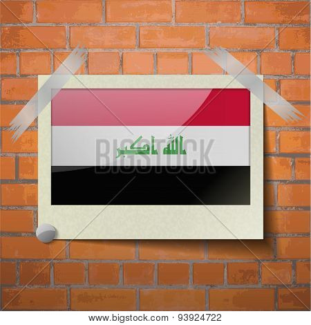 Flags Iraq Scotch Taped To A Red Brick Wall
