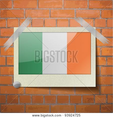 Flags Ireland Scotch Taped To A Red Brick Wall