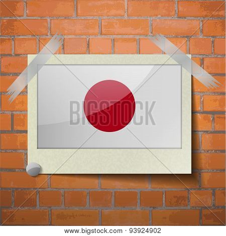 Flags Japan Scotch Taped To A Red Brick Wall