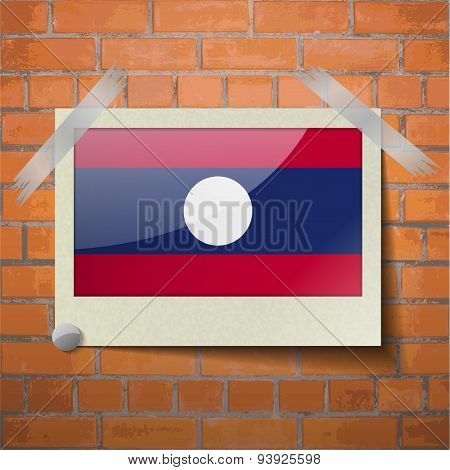 Flags Laos Scotch Taped To A Red Brick Wall