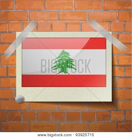 Flags Lebanon Scotch Taped To A Red Brick Wall