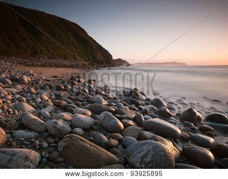Rocky Beach At Sunset.