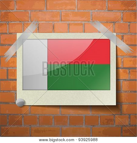 Flags Madagascar Scotch Taped To A Red Brick Wall