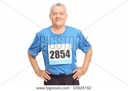 Senior man in sportswear with a race number on his chest looking at the camera isolated on white background