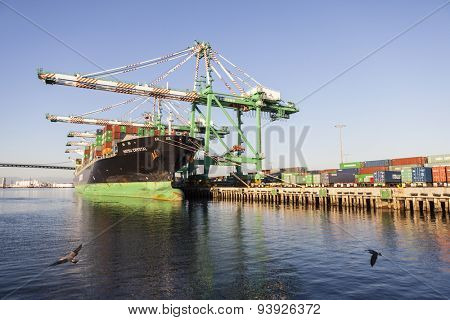 LOS ANGELES, CALIFORNIA, USA - September 25, 2010:  Busy cargo container dock in the congested Los Angeles Harbor.