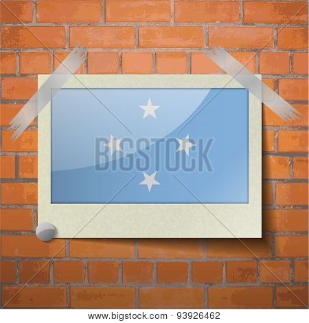 Flags Micronesia Scotch Taped To A Red Brick Wall