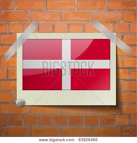 Flags Military Order Malta Scotch Taped To A Red Brick Wall