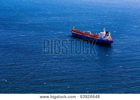 Container Cargo Ship In Blue Ocean