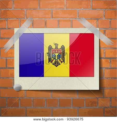 Flags Moldova Scotch Taped To A Red Brick Wall