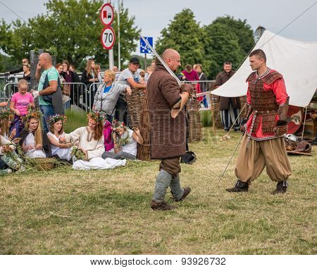 Warsaw, Poland -JUNE 20: Polish man show mastery of the sword on a festival of midsommar near the old town in Warsaw, Poland June 20, 2015