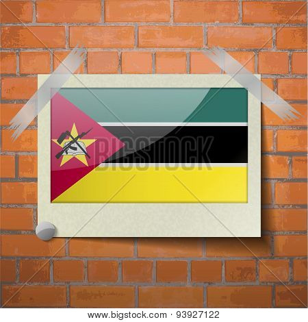 Flags Mozambique Scotch Taped To A Red Brick Wall