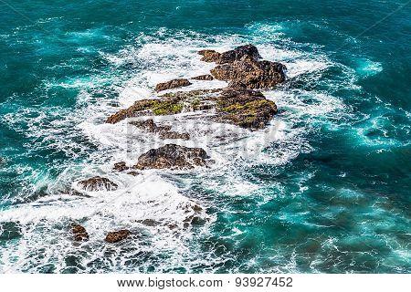 Stones In Waves Of Ocean On Shore