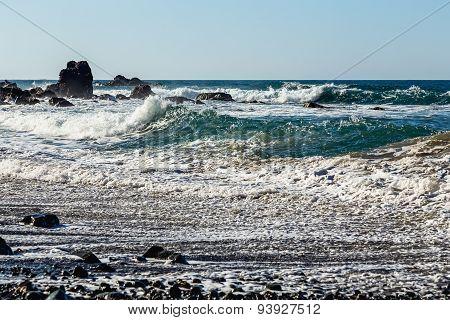 Waves And Foam On Stone Beach