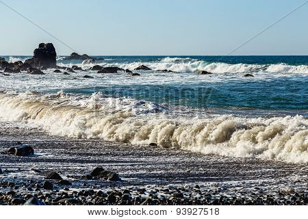 Waves And Foam On Wild Beach