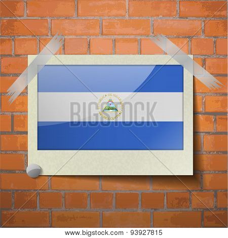 Flags Nicaragua Scotch Taped To A Red Brick Wall