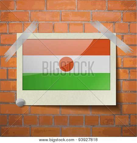 Flags Niger Scotch Taped To A Red Brick Wall
