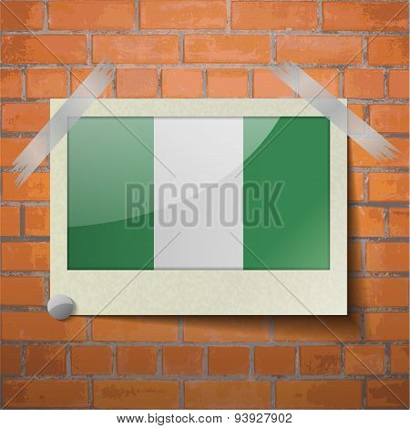 Flags Nigeria Scotch Taped To A Red Brick Wall
