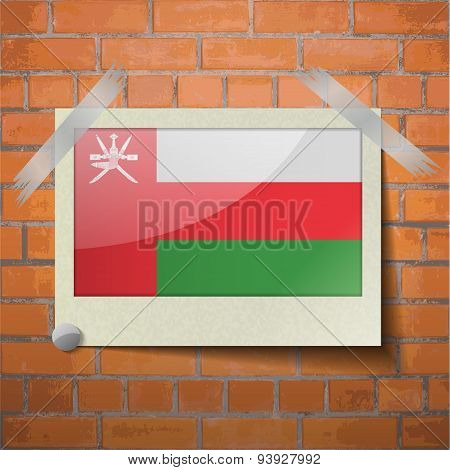 Flags Oman Scotch Taped To A Red Brick Wall