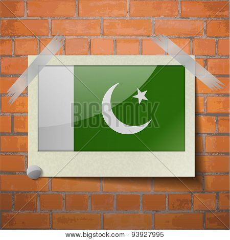 Flags Pakistan Scotch Taped To A Red Brick Wall