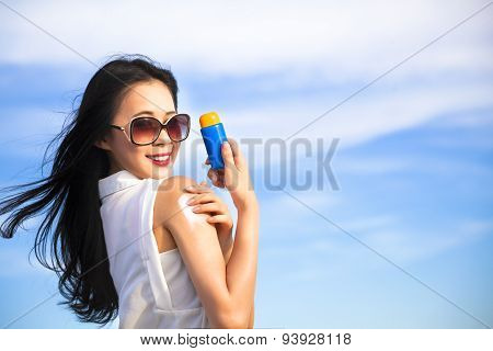 Young Woman Applying Sun Protection Lotion