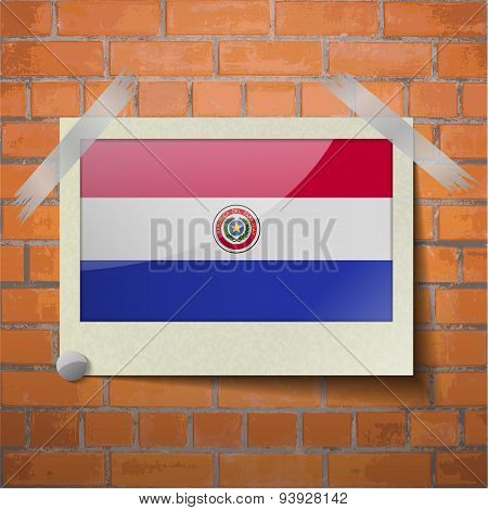 Flags Paraguay Scotch Taped To A Red Brick Wall