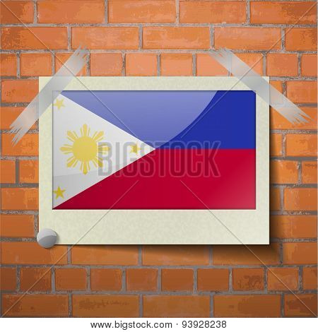 Flags Philippiines Scotch Taped To A Red Brick Wall