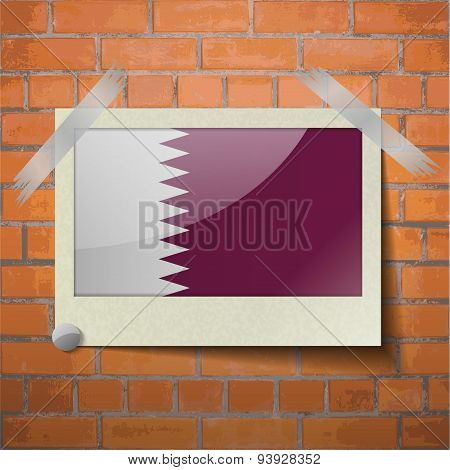 Flags Qatar Scotch Taped To A Red Brick Wall